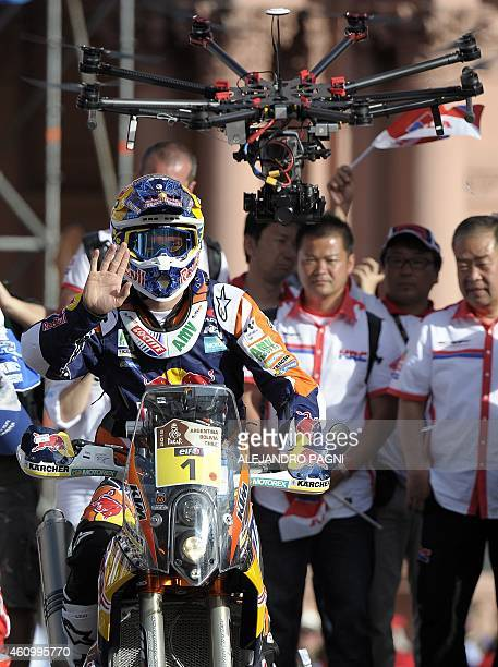Spain's biker Marc Coma of KTM waves on the podium during the symbolic start of the 2015 Dakar Rally in downtown Buenos Aires on January 3 2015 The...