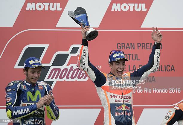 Spain's biker Marc Marquez of Honda celebrates on the podium after winning the MotoGP race of the Argentina Grand Prix ahead of Italy's Valentino...