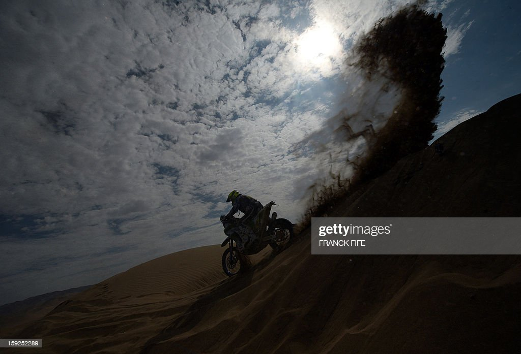 Spain's biker Miguel Puertas Herrera competes in the Stage 6 of the 2013 Dakar Rally between Arica and Calama, Chile, on January 10, 2013. The rally is taking place in Peru, Argentina and Chile from January 5 to 20. AFP PHOTO / FRANCK FIFE