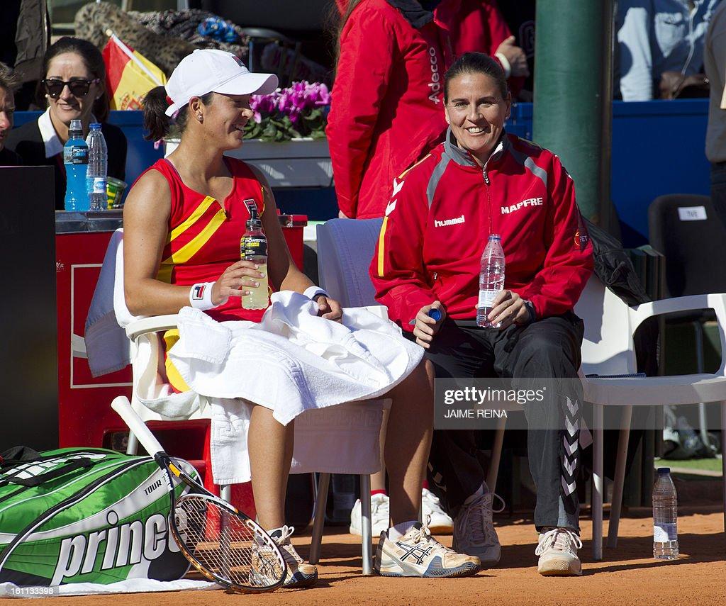 Spain's captain Conchita Martinez (R) and Spain's Silvia Soler smile during the International Tennis Federation Fed Cup World Group 2 match Spain's Silvia Soler vs Ukraine's Lesia Tsurenko. Soler won 7-5, 6-4.