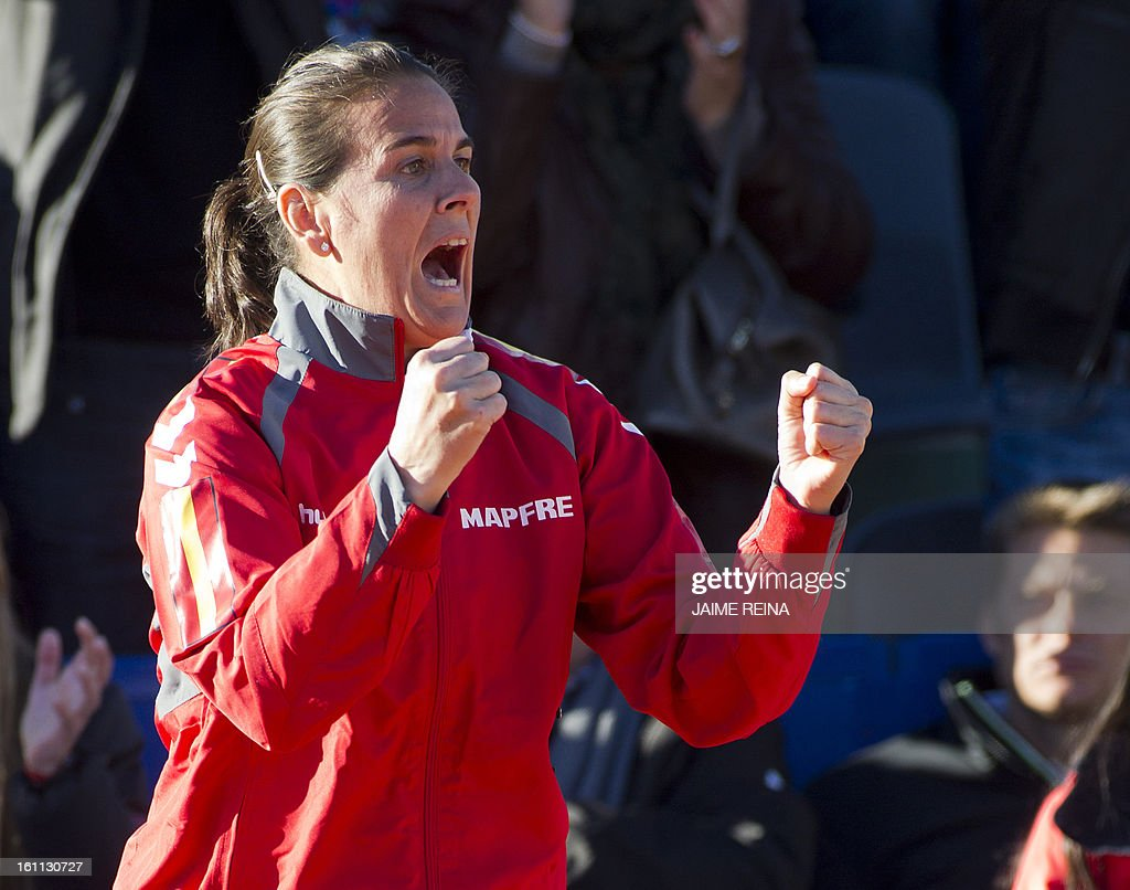 Spain's captain Conchita Martinez celebrates Spain's Silvia Soler's victory at the end of the International Tennis Federation Fed Cup World Group 2 match Soler vs Ukraine's Lesia Tsurenko in Alicante on February 9, 2013. Soler won 7-5, 6-4. AFP PHOTO/ JAIME REINA