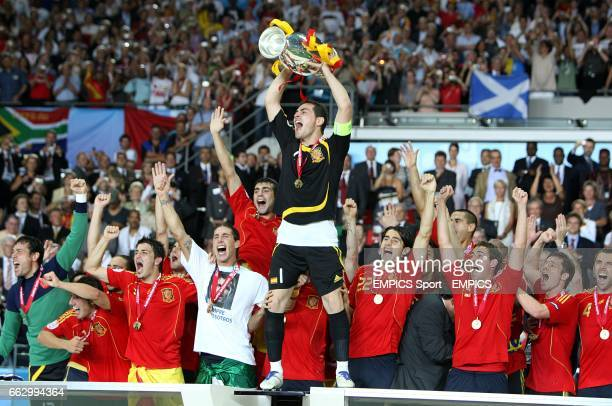 Spain's captain Iker Casillas and his team mates celebrate with the European Trophy