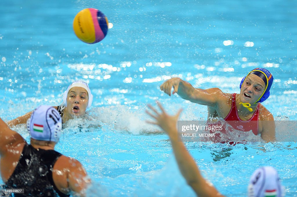 Spain's captain Jennifer Pareja shoots to score during the women's water polo semifinal match Hungary vs Spain at the London 2012 Olympic Games on...