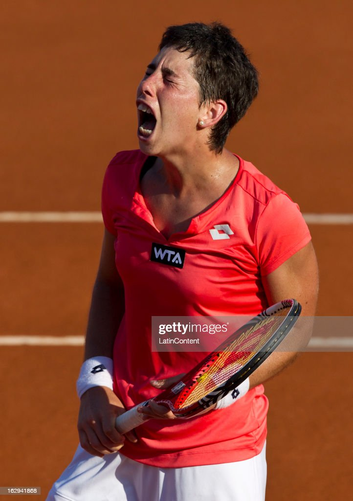 Spain´s Carla Suarez celebrates after winning a match against Spain´s Silvia Soler during the Acapulco Tennis Open in the Pacific resort in Acapulco, Monday, March 1, 2013