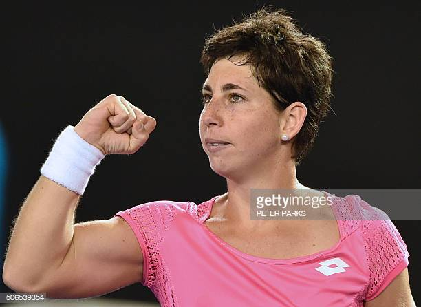 Spain's Carla Suarez Navarro gestures after victory in her women's singles match against Australia's Daria Gavrilova on day seven of the 2016...