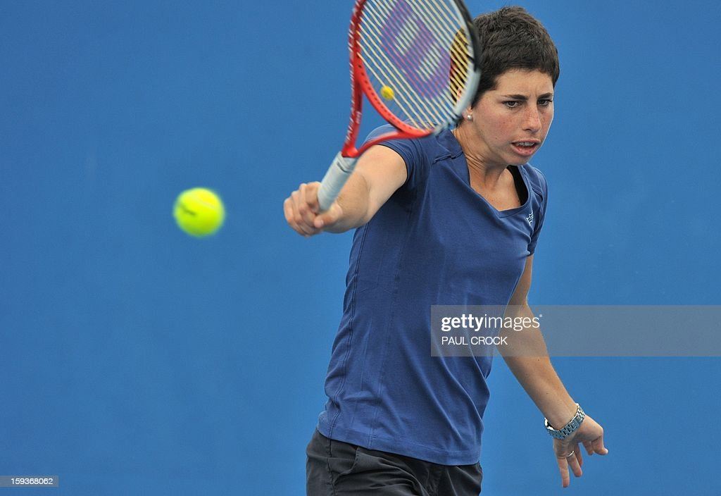 Spain's Carla Suarez Navarro hits a return during a training session ahead of the Australian Open tennis tournament in Melbourne on January 13, 2013.
