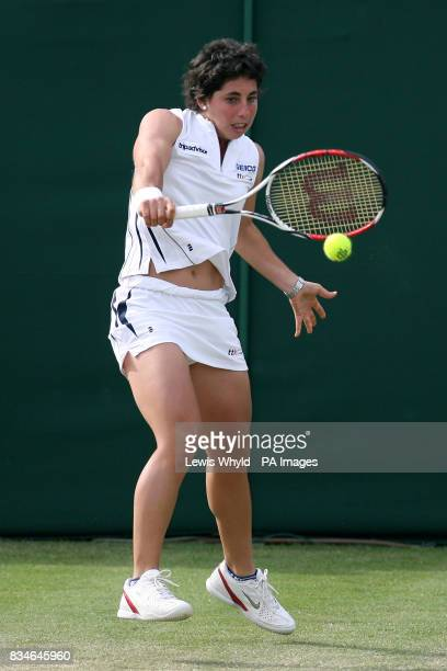 Spain's Carla Suarez Navarro in action against Serbia's Jelena Jankovic during the Wimbledon Championships 2008 at the All England Tennis Club in...