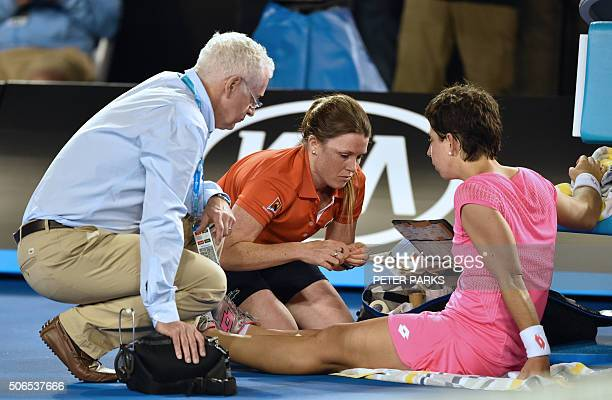 Spain's Carla Suarez Navarro is treated for an injury during her women's singles match against Australia's Daria Gavrilova on day seven of the 2016...