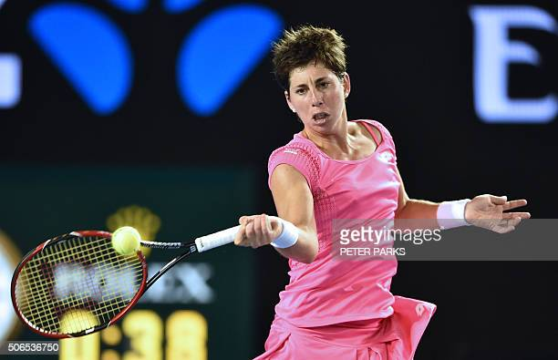 Spain's Carla Suarez Navarro plays a forehand return during her women's singles match against Australia's Daria Gavrilova on day seven of the 2016...