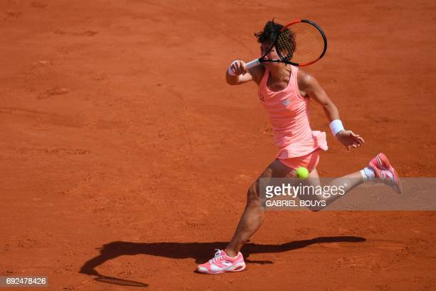 Spain's Carla Suarez Navarro returns the ball to Romania's Simona Halep during their tennis match at the Roland Garros 2017 French Open on June 5...