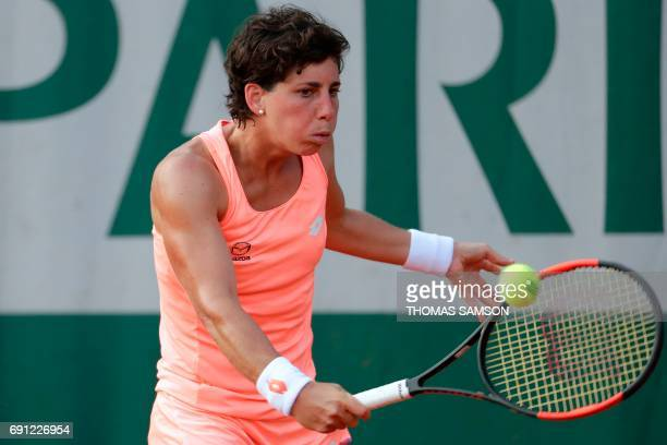 Spain's Carla Suarez Navarro returns the ball to Romania's Sorana Cirstea during their tennis match at the Roland Garros 2017 French Open on June 1...