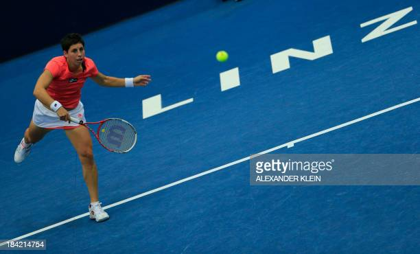 Spain's Carla Suarez Navarro serves the ball during her semi final match against Germany's Angelique Kerber as part of the WTA tennis tournament held...