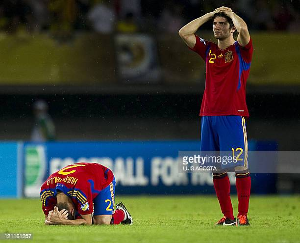 Spain's Carles Planas and Hugo Mallo react in dejection at the end of the FIFA Under20 World Cup quarterfinal football match against Brazil at Hernan...