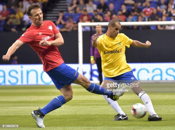 Spain's Carlos Marchena vies with Brazil's Rivaldo during the Star Sixes 3rd place playoff football match between Spain and Brazil at the O2 Arena in...
