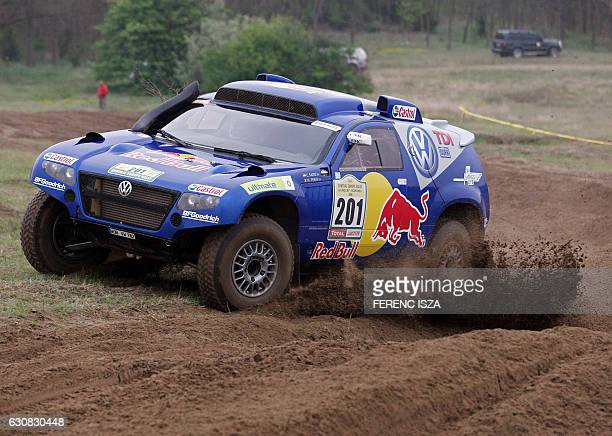 Spain's Carlos Sainz and French codriver Michel Perin speed their Volkswagen during the fourth stage of the Central European Rally near...