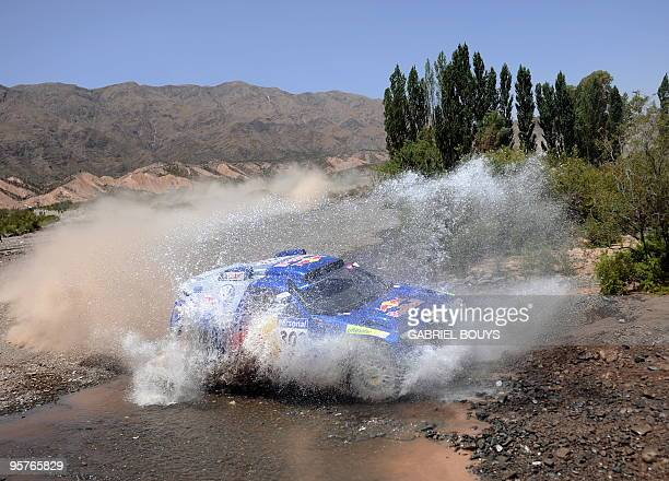 Spain's Carlos Sainz steers his Volkswagen during the 11th stage of the Dakar 2010 between Santiago Chile and San Juan Argentina on January 13 2010...