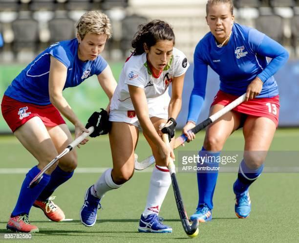 Spain's Carmen Cano vies with Czech Republic's Klara Poloprutska and Adela Lehovcova during the women's Hockey Rabo EuroHockey Championships 2017...