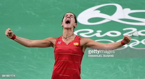 Spain's Carolina Marin reacts after winning against India's Pusarla V Sindhu during their women's singles Gold Medal badminton match at the Riocentro...