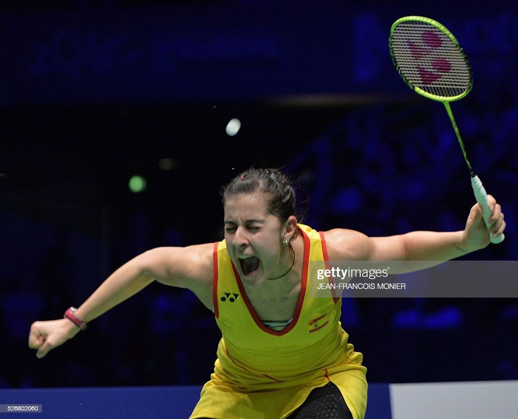 Spain s Carolina Marin reacts after winning to Scottish Kirsty