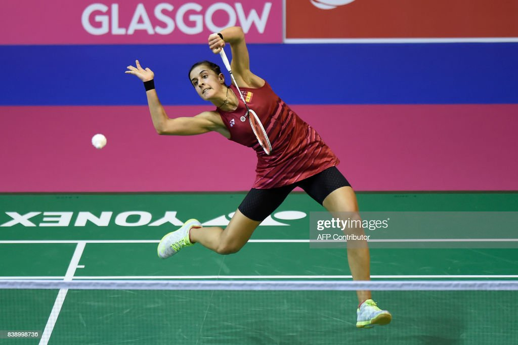 Spain's Carolina Marin returns during her quarter-final women's singles match against Japan's Nozomi Okuhara during the 2017 BWF World Championships of badminton at Emirates Arena in Glasgow on August 25, 2017. /