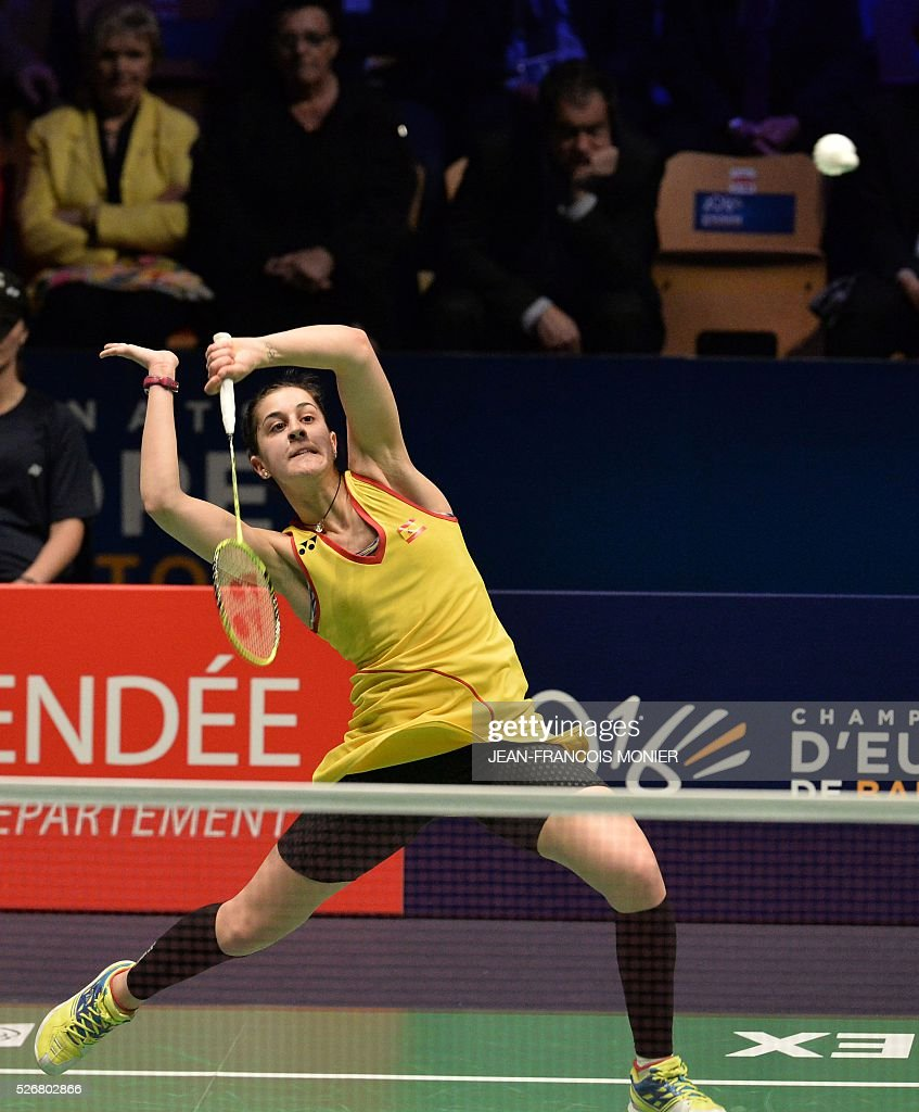 Spain s Carolina Marin returns the ball to Scottish Kirsty Gilmour