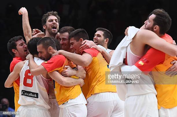 Spain's center Pau Gasol and his teammates celebrate after Spain defeated Greece in their round of 8 basketball match at the EuroBasket 2015 in Lille...