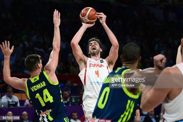 Spain's center Pau Gasol attempts to score next to Slovenia's center Luka Gasper and Anthony Randolph during the FIBA Eurobasket 2017 men's semifinal...