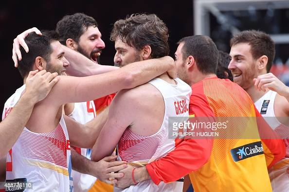 Spain's center Pau Gasol celebrates with his teammates after defeating France in the semifinal basketball match between Spain and France at the...