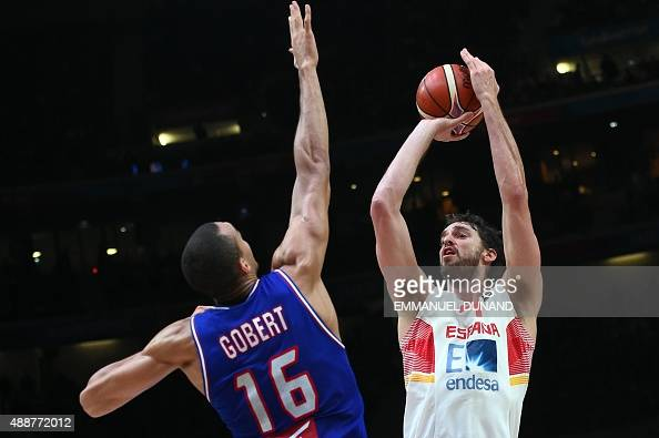 Spain's center Pau Gasol takes a shot despite France's center Rudy Gobert during the semifinal basketball match between Spain and France at the...