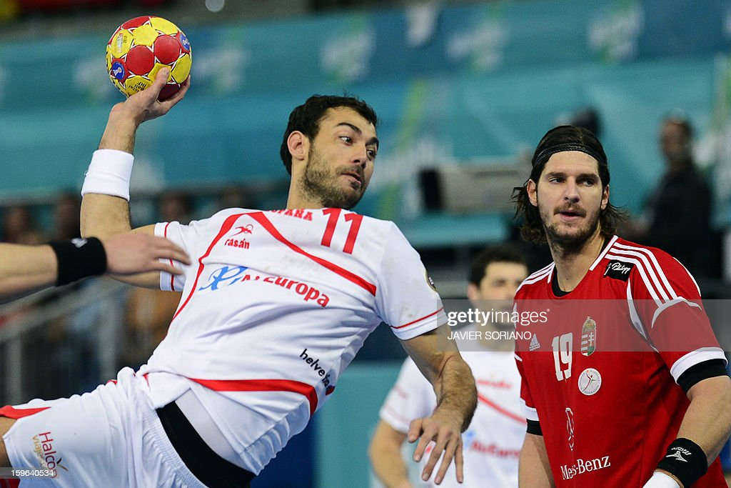 Spain's centre back Daniel Sarmiento (L) shoots past Hungary's right back Laszlo Nagy (R) during the 23rd Men's Handball World Championships preliminary round Group D match Hungary vs Spain at the Caja Magica in Madrid on January 17, 2013. AFP PHOTO/ JAVIER SORIANO