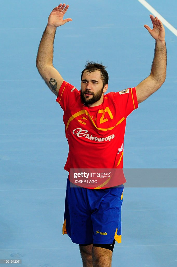 Spain's centre back Joan Canellas reacts during the 23rd Men's Handball World Championships final match Spain vs Denmark at the Palau Sant Jordi in Barcelona on January 27, 2013. AFP PHOTO/ JOSEP LAGO