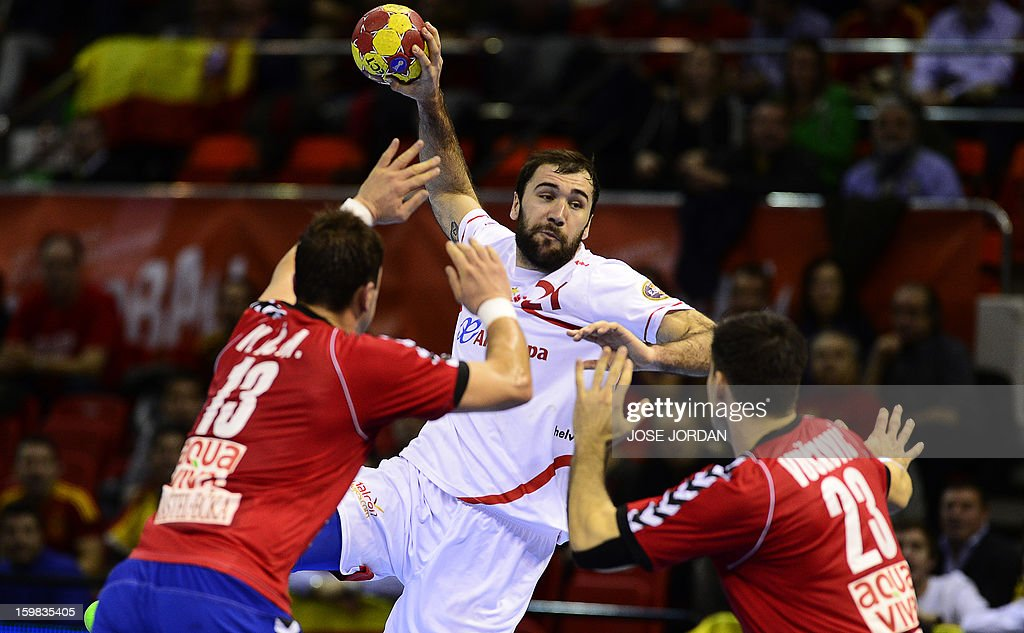 Spain's centre back Joan Canellas (C) vies with Serbia's left back Momir Ilic and Serbia's centre back Nenad Vuckovic (R) during the 23rd Men's Handball World Championships round of 16 match Serbia vs Spain at the Pabellon Principe Felipe in Zaragoza on January 21, 2013.