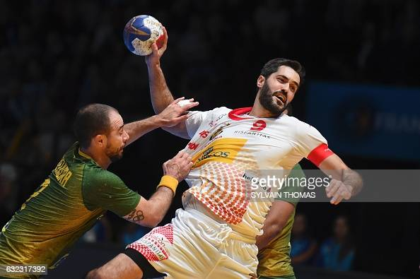 TOPSHOT Spain's centre back Raul Entrerrios jumps to shoot on goal despite Brazil's centre back Henrique Teixeira during the 25th IHF Men's World...