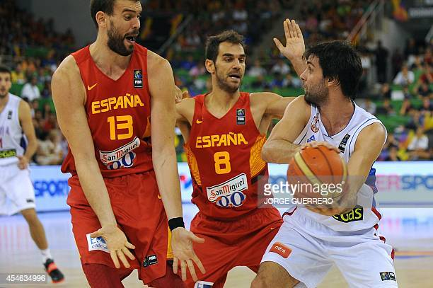 Spain's centre Marc Gasol and guard Jose Calderon vie with Serbia's guard Milos Teodosic during the 2014 FIBA World basketball championships group A...