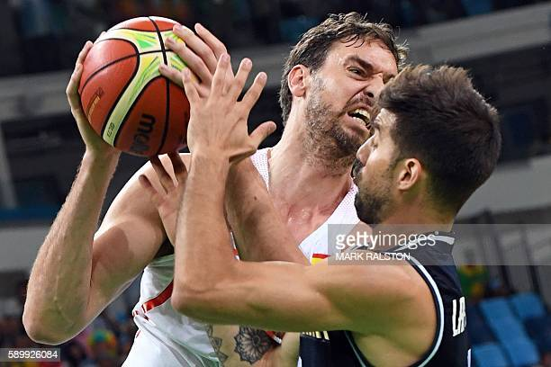TOPSHOT Spain's centre Pau Gasol and Argentina's point guard Nicolas Laprovittola go for the all during a Men's round Group B basketball match...