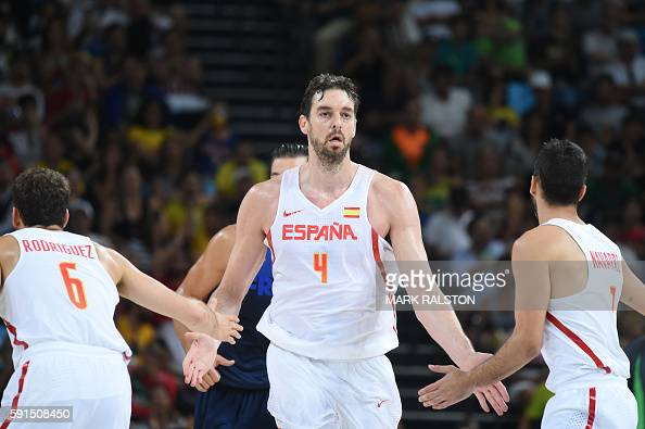 Spain's centre Pau Gasol celebrates a point with Spain's point guard Sergio Rodriguez and Spain's guard JuanCarlos Navarro during a Men's...