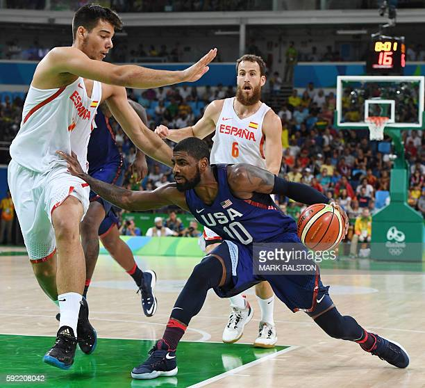 Spain's centre Willy Hernangomez blocks USA's guard Kyrie Irving during a Men's semifinal basketball match between Spain and USA at the Carioca Arena...