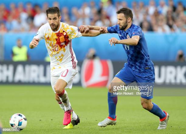 Spain's Cesc Fabregas and Croatia's Milan Badelj battle for the ball