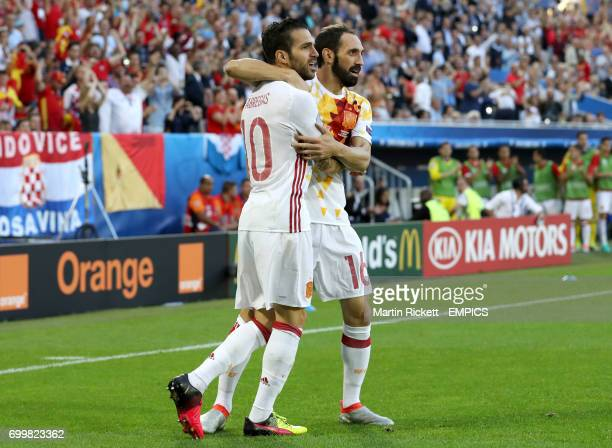 Spain's Cesc Fabregas and team mate Spain's Juanfran celebrates Spain's Alvaro Morata scoring his side's first goal of the game to which Fabregas...