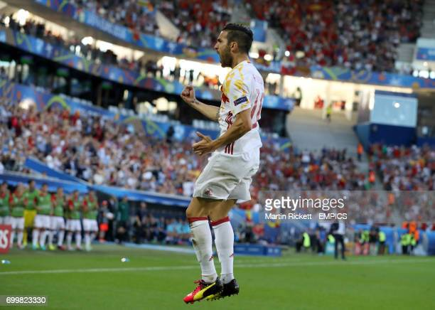 Spain's Cesc Fabregas celebrates assisting his side's first goal of the game scored by Alvaro Morata