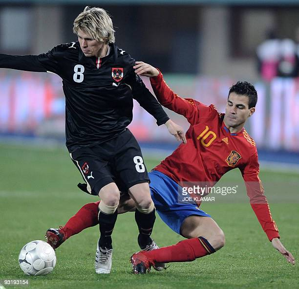 Spain's Cesc Fabregas fights for a ball with Austria's Christoph Leitgeb during their friendly match between Austrian and Spain at Ernst Happel...