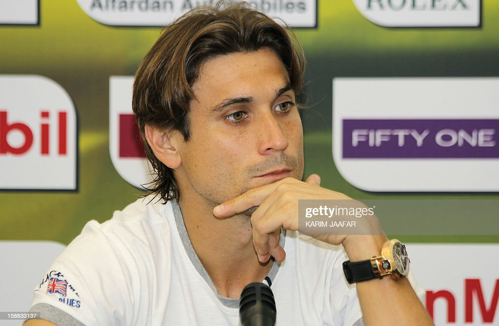 Spain's champion David Ferrer looks on during a press conference on the first day of the 2013 ATP Qatar Open in Doha on December 31, 2012.