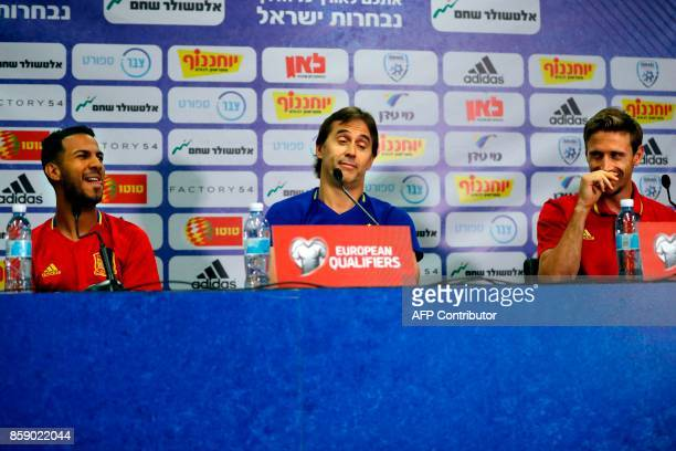 Spain's coach Julen Lopetegui and national football team players Spain's defender Ignacio Monreal and midfielder Jonathan Viera react during a press...