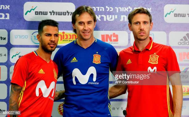 Spain's coach Julen Lopetegui and national football team players Spain's defender Ignacio Monreal and midfielder Jonathan Viera pose for a picture...