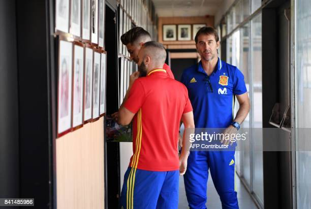 Spain's coach Julen Lopetegui Spain's defender Sergio Ramos and Spain's midfielder Andres Iniesta leave after giving a press conference at the Royal...