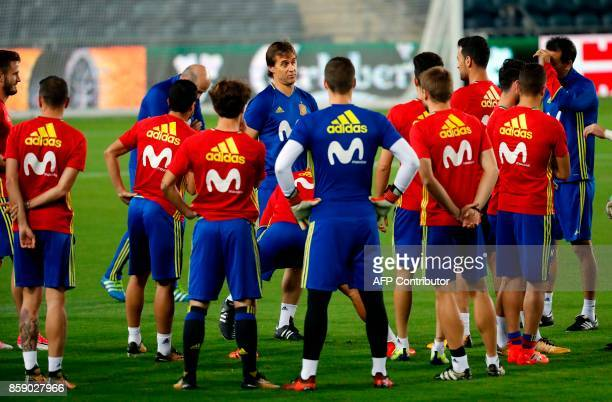 Spain's coach Julen Lopetegui talks to his team players during a training session at the Teddy stadium in Jerusalem on October 8 a day ahead of the...