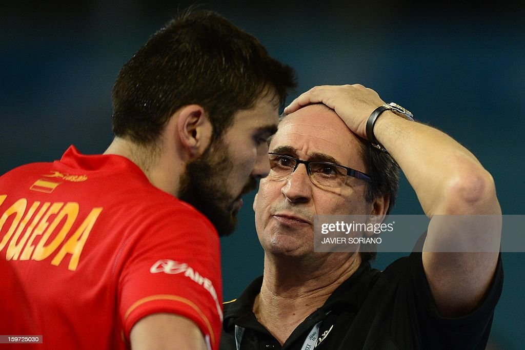 Spain's coach Valero Rivera (R) talks with Spain's right back Jorge Maqueda during the 23rd Men's Handball World Championships preliminary round Group D match Spain vs Croatia at the Caja Magica in Madrid on January 19, 2013.