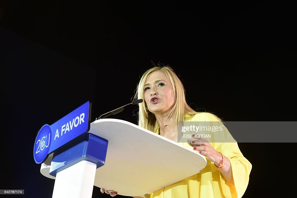 Spain's conservative Popular Party (PP) member Cristina Cifuentes speaks during the partys final campaign meeting in Madrid on June 24, 2016 ahead of the June 26 general election. Spain votes again on June 26, six months after an inconclusive election which saw parties unable to agree on a coalition government. JORDAN