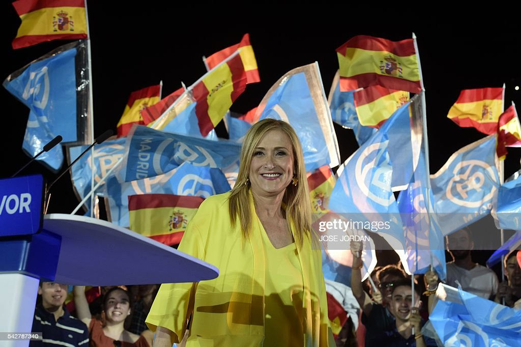 Spain's conservative Popular Party (PP) member Cristina Cifuentes stands during the partys final campaign meeting in Madrid on June 24, 2016 ahead of the June 26 general election. Spain votes again on June 26, six months after an inconclusive election which saw parties unable to agree on a coalition government. JORDAN