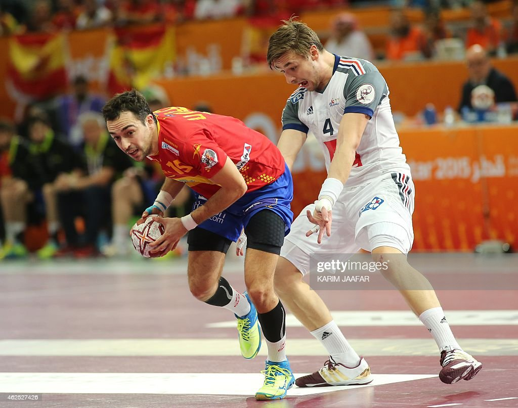 Spain's Cristian Ugalde (L) runs as France's <a gi-track='captionPersonalityLinkClicked' href=/galleries/search?phrase=Xavier+Barachet&family=editorial&specificpeople=4312948 ng-click='$event.stopPropagation()'>Xavier Barachet</a> gestures during the 24th Men's Handball World Championships semi-finals match between Spain and France at the Lusail Multipurpose Hall in Doha on January 30, 2015.